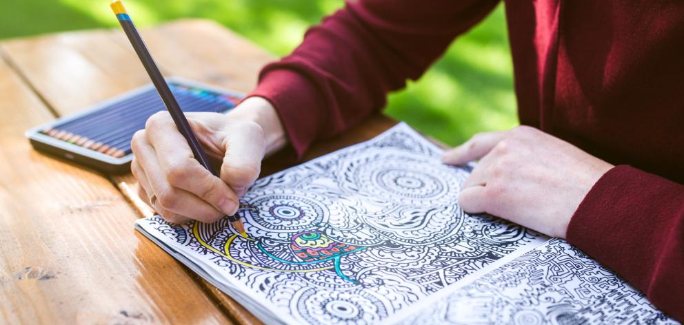 After a week, the study found those who had been colouring-in reported lower levels of depressive symptoms and anxiety. Photo: Getty Images