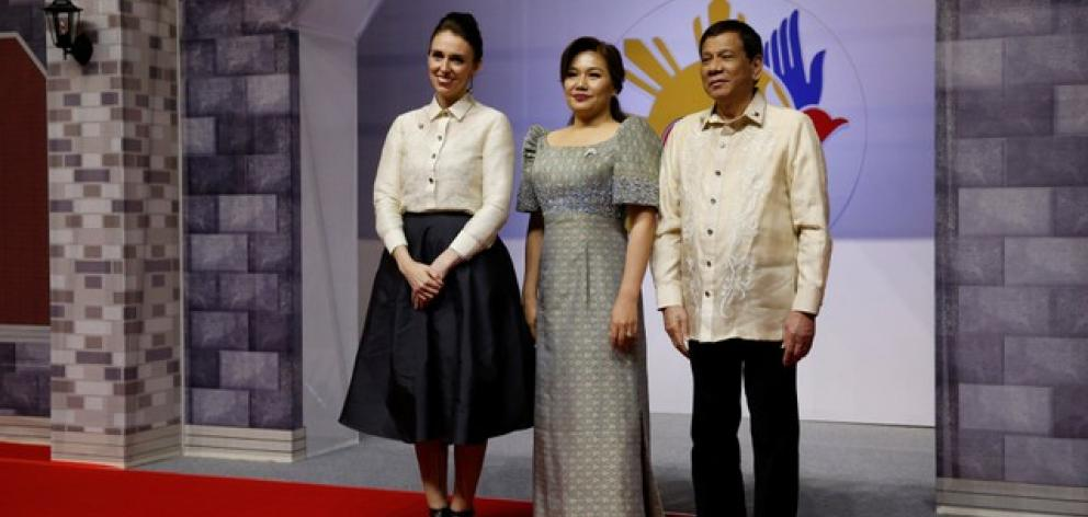 Jacinda Ardern poses with Philippines President Rodrigo Duterte and Honeylet Avancena as she attends the ASEAN Summit gala. Photo: Reuters