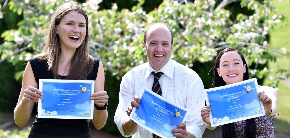 Southern Innovation Challenge chief executive award winner Kristina Aluzaite (left)  with staff...