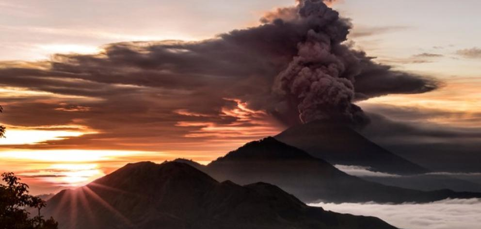 Mount Agung volcano is seen spewing smoke and ash in Bali. Photo: Emilion Kuzma-Floyd @eyes_of_a_nomad via Reuters