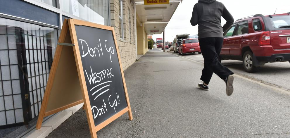 A sign outside another Ranfurly store lobbies for the bank to remain open.
