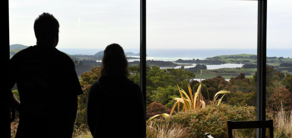 Carey and Tracey Hancox look out over  Catlins Lake and Owaka Heads from their lodge. Photos:...