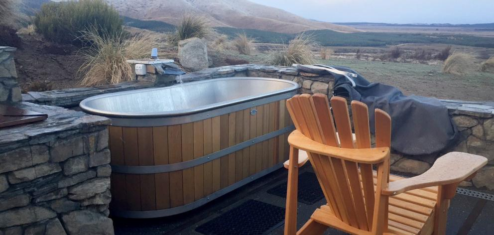 Skyscape's outdoor bath is the ideal way to unwind at the end of a day. Photo: Bob MacLachlan