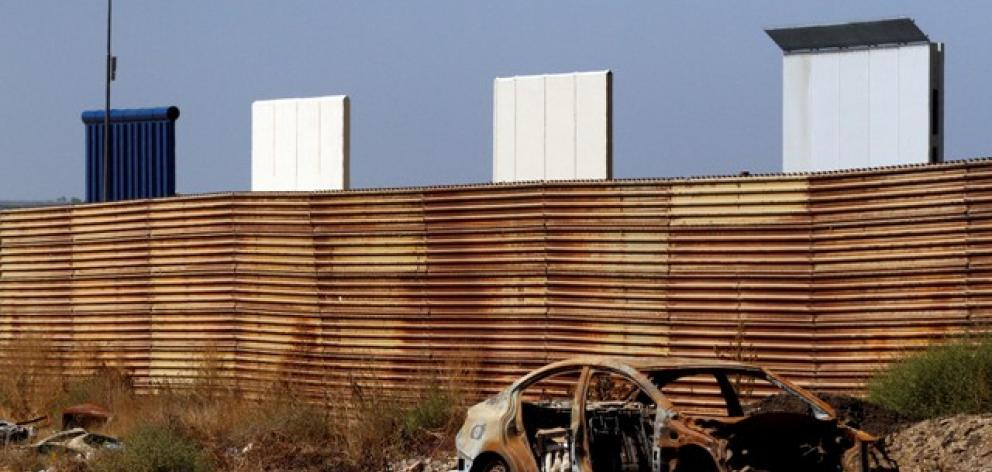 Prototypes for US President Donald Trump's border wall with Mexico are seen behind the current border fence in this picture taken from the Mexican side of the border in Tijuana. Photo: Reuters