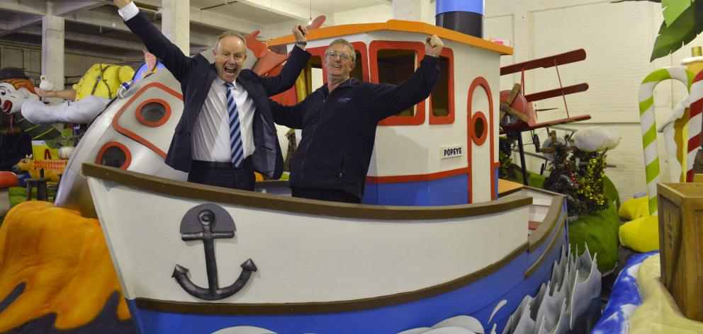 Dunedin Santa Parade Trust chairman Mark Laughton (left) and trustee Peter Price are counting...