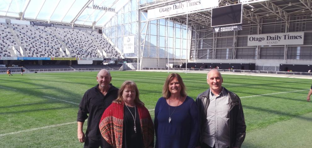 Looking forward to the Christmas in the Stadium event on December 2 are (from left) Acts of Kindness Charitable Trust members Grant and Anne Hardy, Dunedin Venues Ltd marketing manager Kim Barnes and trustee John Watson. PHOTO: BRENDA HARWOOD