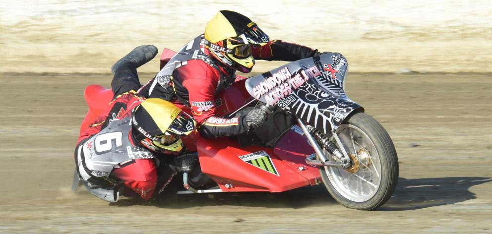 Invercargill's Erwin Tree and passenger Bret Pubben tear around the track on their sidecar outfit at Beachlands Speedway near Dunedin last night. Photo: Gregor Richardson