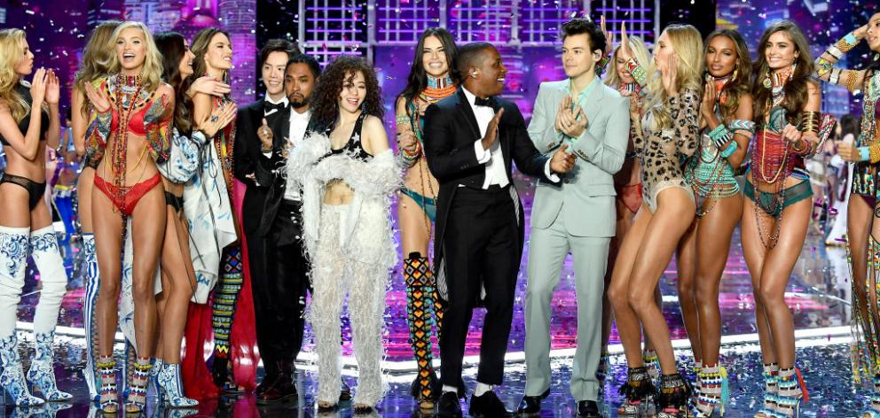Singers Leslie Odom Jr. and Harry Styles at the 2017 Victoria's Secret Runway Show with this year's models. Kiwi Stella Maxwell on the far-left. Photo: Getty Images