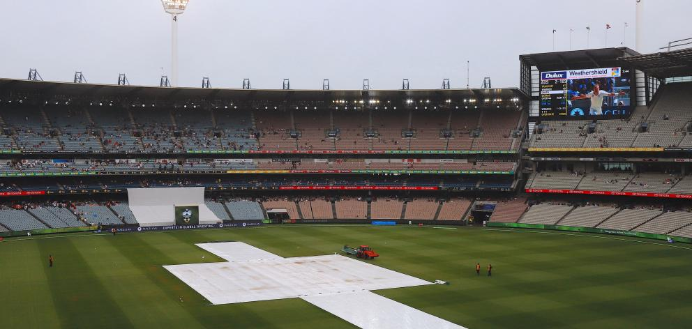 A moist Melbourne Cricket Ground on the fourth day of the fourth Ashes test. Photo: Reuters