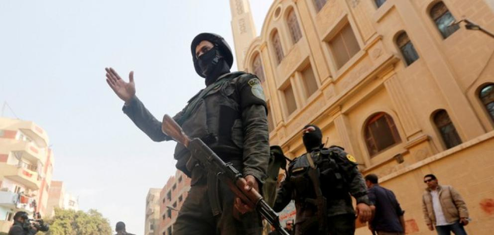 Security forces stand guard at the site of attack on Mar Mina church in Helwan district on the outskirts of Cairo
