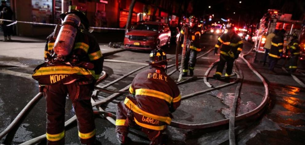 FDNY personnel work on the scene of an apartment fire in Bronx. Photo: Reuters