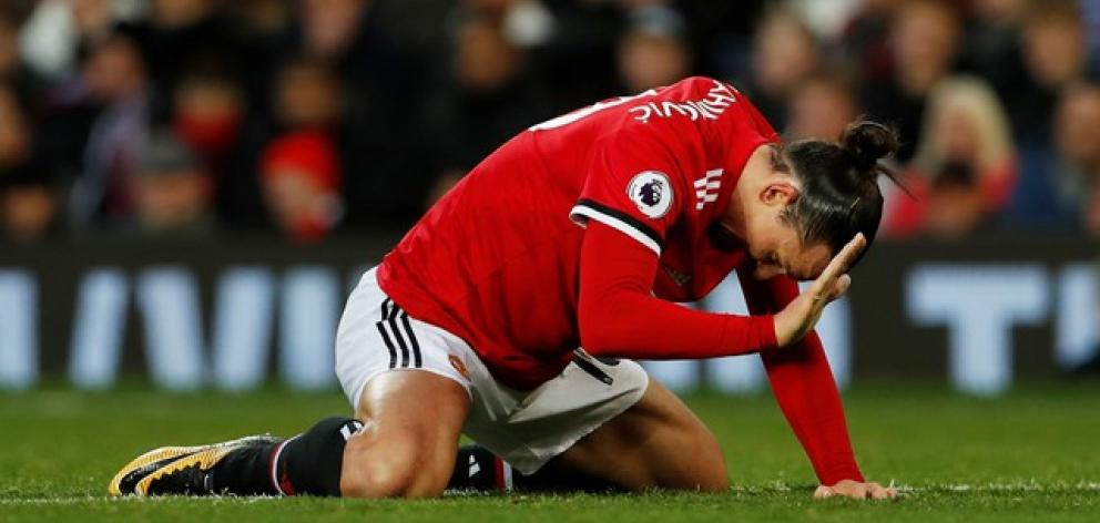 After sustaining a knee injury Manchester United striker Zlatan Ibrahimovic will be sidelined for a month. Photo: Reuters