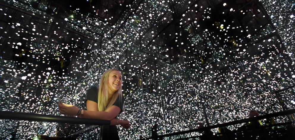 Otago Museum marketing manager Charlotte Neilson experiences  an  ''Infinity Room'' created as...