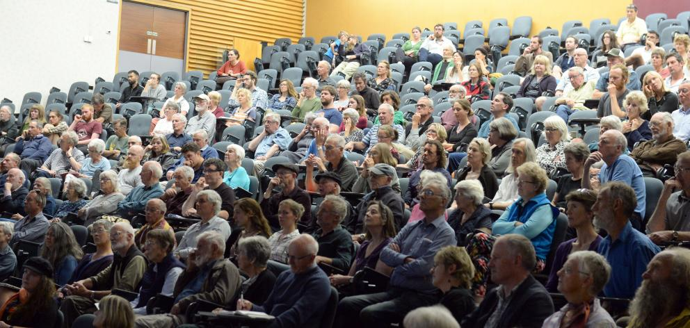 The audience is absorbed as Massey University freshwater ecologist Dr Mike Joy discusses ``The...