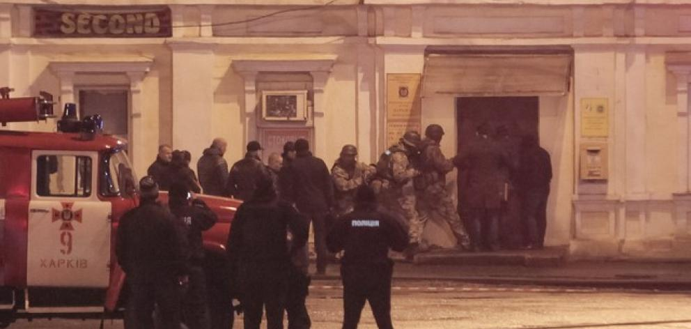 Members of a police special operations unit gather outside a post office, where a man took people hostage, in Kharkiv. Photo: Reuters