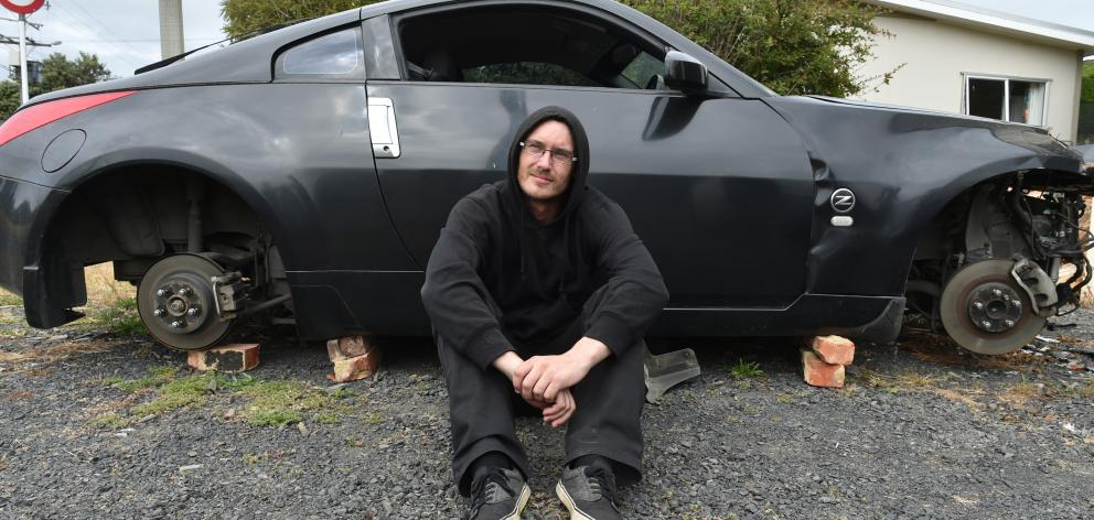 Westwood resident Simon Little is upset the wheels from his written-off Nissan have been stolen. Photo: Gregor Richardson