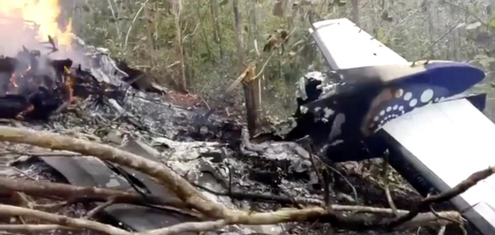 Wreckage in flames after a plane crashed in the mountainous area of Punta Islita, in the province...