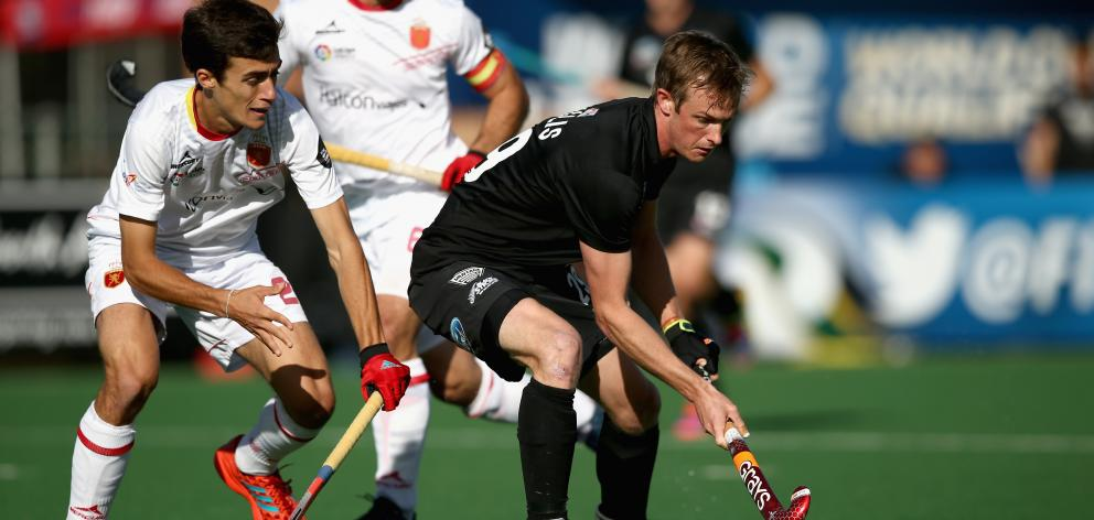Black Sticks striker Hugo Inglis (right) holds off Marc Serrahima, of Spain, in a Hockey World...