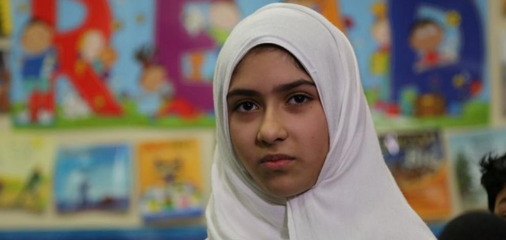 Khawlah Noman speaks to reporters at Pauline Johnson Junior Public School in Toronto. Photo: Reuters
