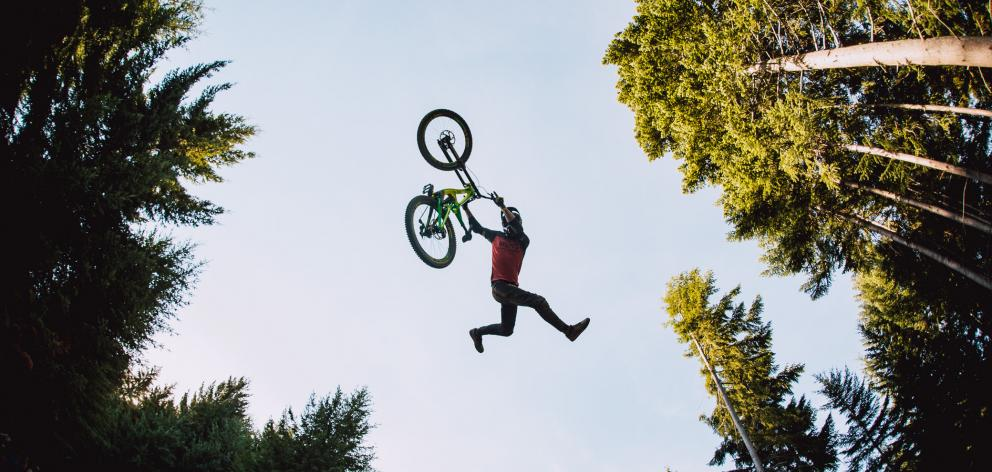 Queenstown rider Conor MacFarlane performs a Superman Indian Air trick during a jump jam at the...