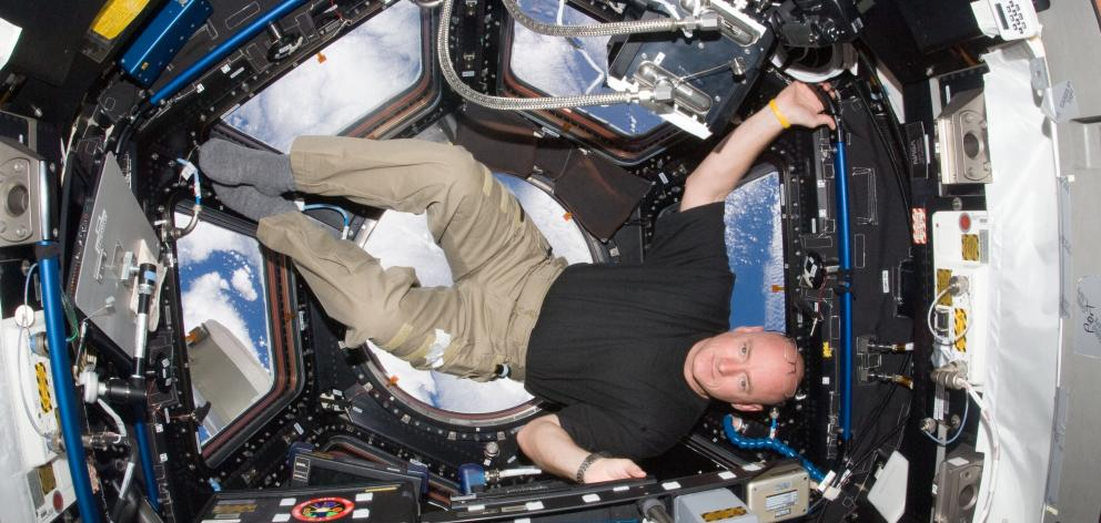 Scott Kelly in the cupola of the International Space Station.