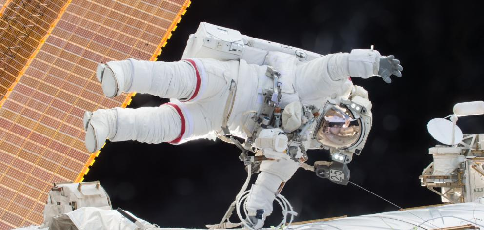 Scott Kelly during a space walk to prepare the International Space Station for the docking of a...