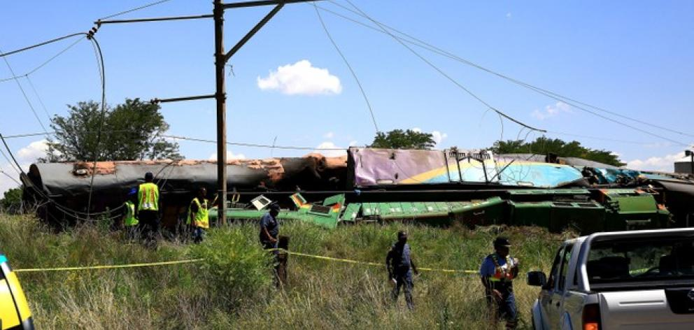 The train, which was carrying 700 passengers, jumped the tracks after hitting the truck, which was attempting to negotiate a level crossing. Photo: Reuters