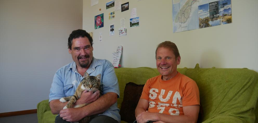 Couch surfer Stefan Weber (right) is one of more than 200 people Gary Green and his cat Monster have hosted since March last year.  PHOTO: JESSICA WILSON
