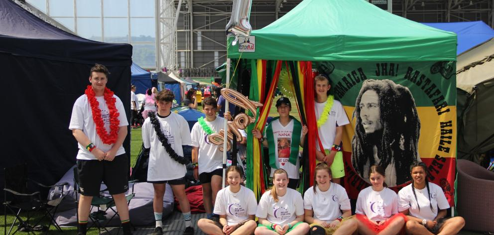Members of the One Love Relay for Life team relax at their tent site, which had a Bob Marley theme, during the 2016 event at Forsyth Barr Stadium. PHOTO: SUPPLIED