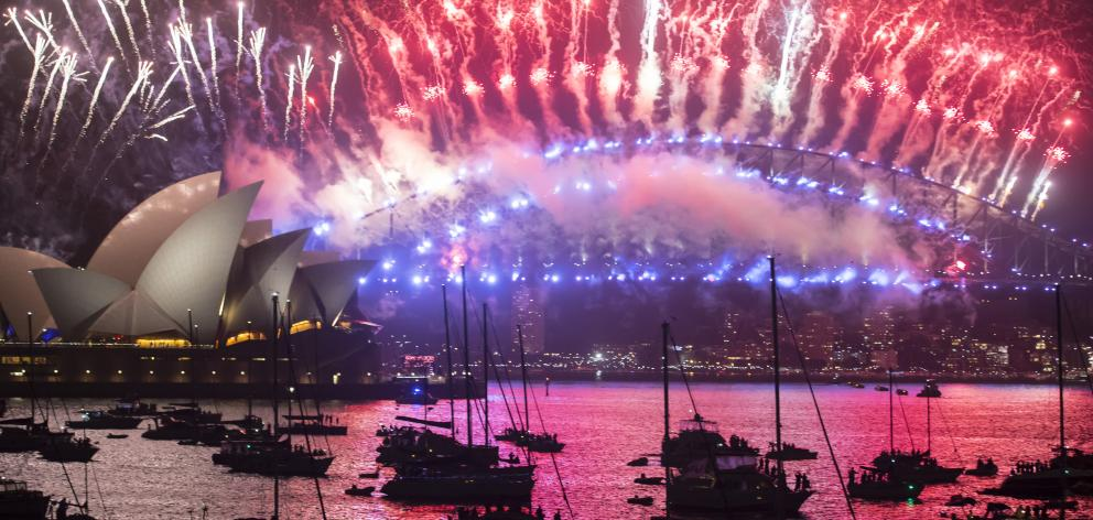 Fireworks above the Opera House and Harbour Bridge for New Year's Eve on January 1, 2018 in...