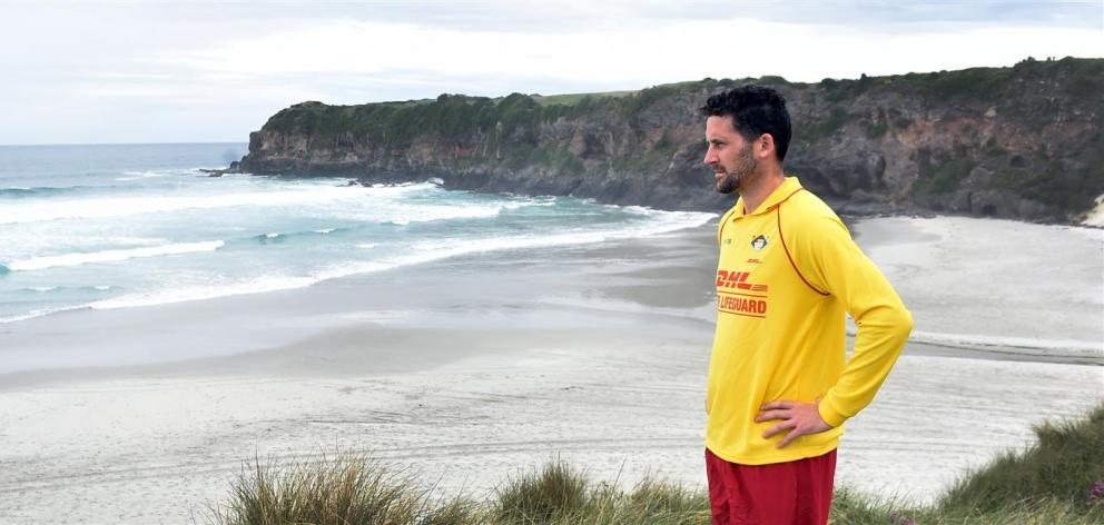 St Clair Surf Life Saving Club chairman James Coombes looks out over Tomahawk Beach where lifeguard patrols will be re-established early next year. Photo: Peter McIntosh