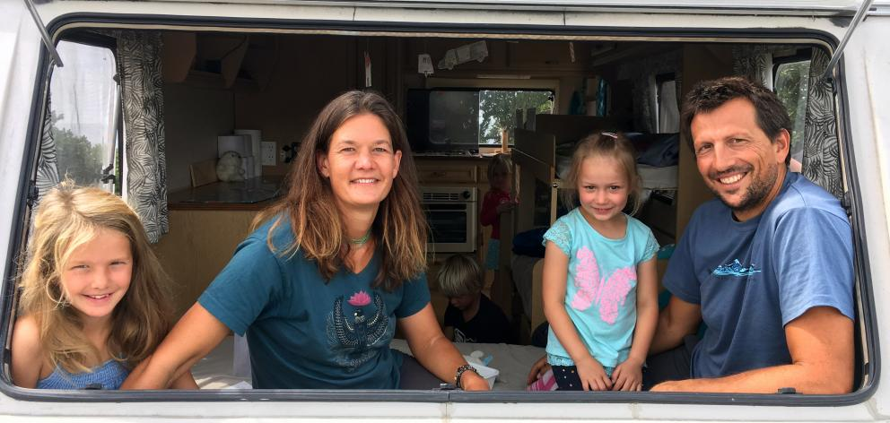 German freedom campers (from left) Antonia (8) and Anke Roser, Elisa Bauer (5) and Jochen Roser relax in a caravan at Brighton Domain last week. PHOTO: SHAWN MCAVINUE