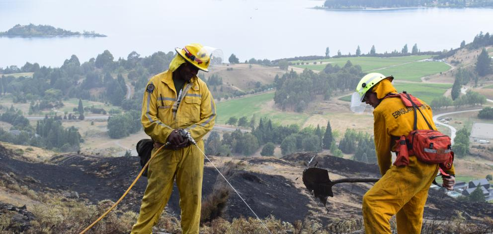 Fire officers Joe Natuikata and Johnathon Moate, of Gore, at work on Mt Alpha. Photo: Kerrie...