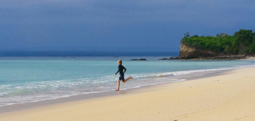 The deserted beach where the kids and I went swimming and paddle-boarding every day. We even got...