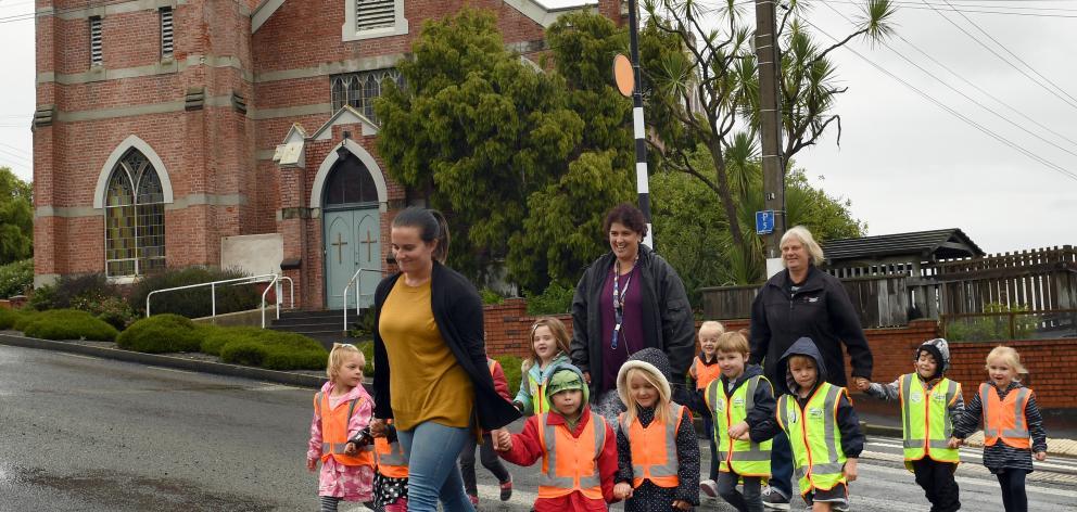 teachers (from left) Kim Ruthven and Roberta Carvalho, and head teacher Lyn Morton,  cross the...