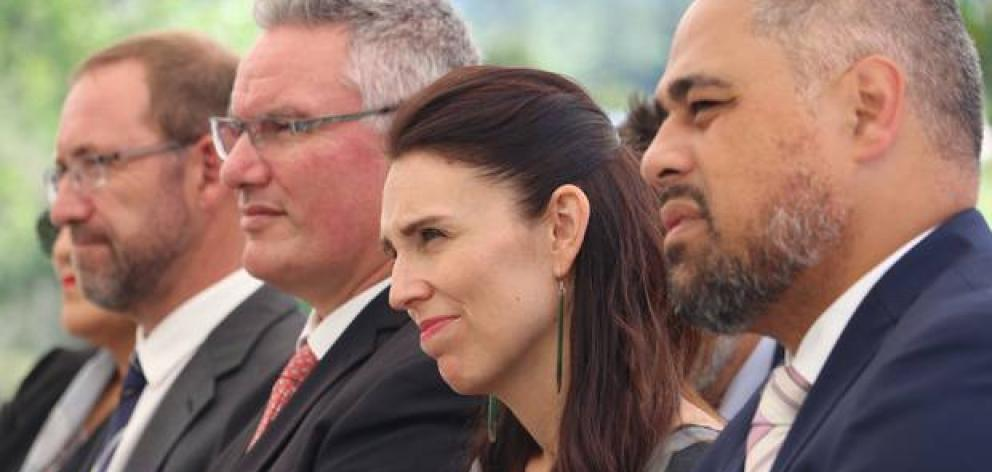 Prime Minister Jacinda Ardern listens to a welcome from Maori Wardens at Bay of Islands Holiday Park with, from left, Ministers Andrew Little, Kelvin Davis and Peeni Henare. Photo: NZ Herald