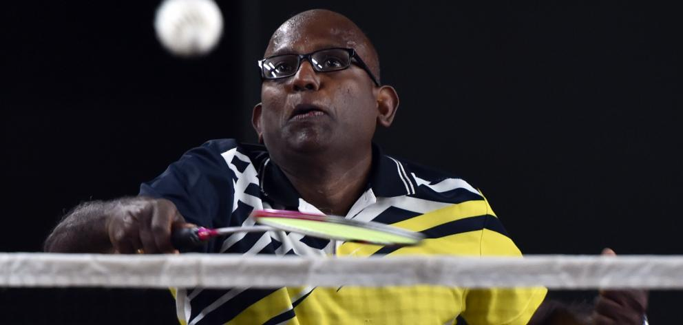 Dev Senthiya  is all concentration during the  badminton at the New Zealand Masters Games...