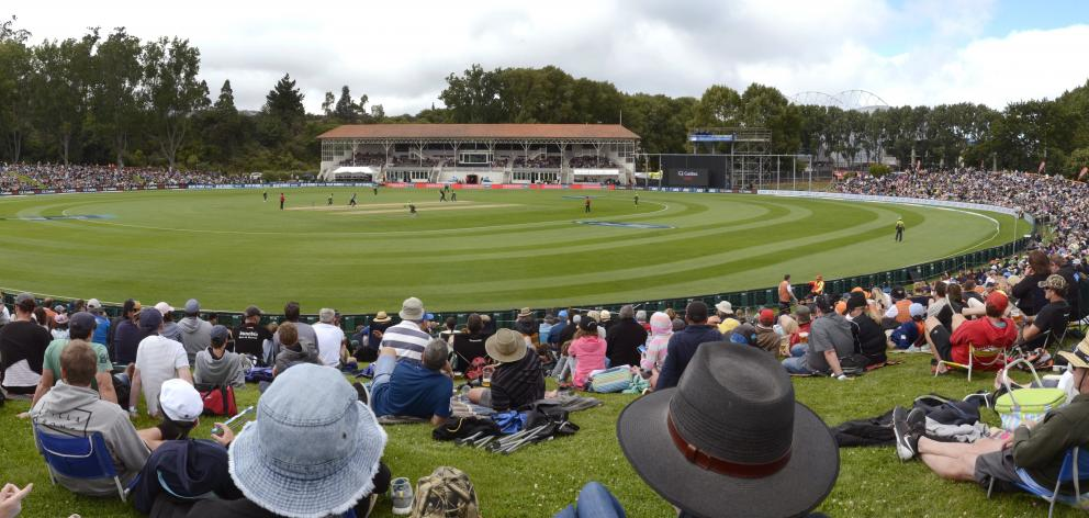 A crowd settles in around Dunedin's ''village green'', the University Oval, last month. Photo:...