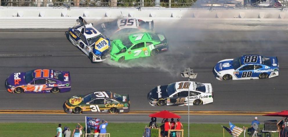 hase Elliott (9), Kasey Kahne (95) and Danica Patrick (7) crash during the Daytona 500 at Daytona International Speedway. Photo: Mark J. Rebilas-USA TODAY Sports
