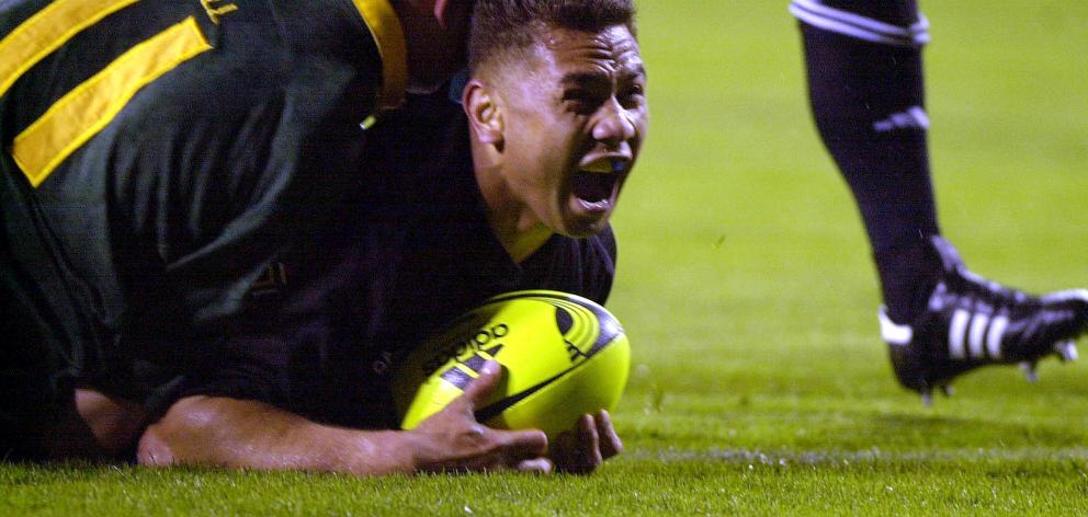 Pita Alatini scores a try for the All Blacks against South Africa during a Tri-Nations test at...