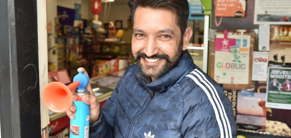 Caversham Dairy owner Harry Singh and his air horn which he hopes to upgrade to a fog cannon....