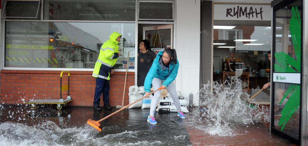 Kymberlee Choie (18)  keeps the water out of the family's fish and chip shop in Gordon Rd,...