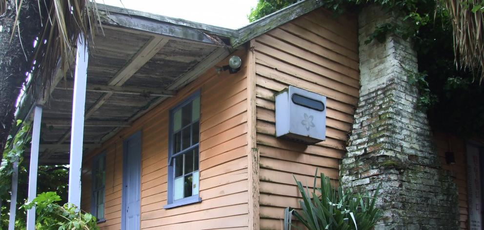 The owners of Gratuity Cottage, one of Queenstown's oldest dwellings, are looking for new owners...