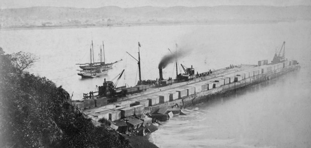 The Oamaru Harbour breakwater while under construction in the 1870s. Photo: Waitaki District...