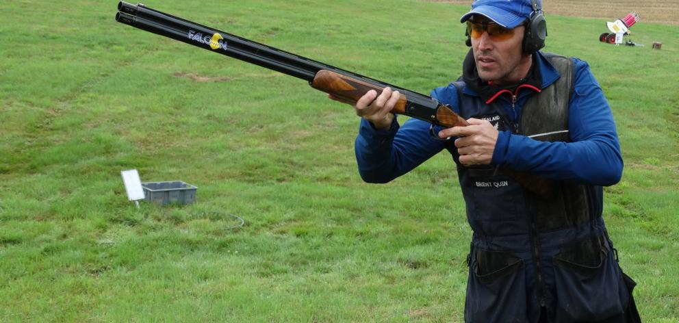 Brent Quin, of Wellington, shoots at the New Zealand Clay Target Association grand prix in...