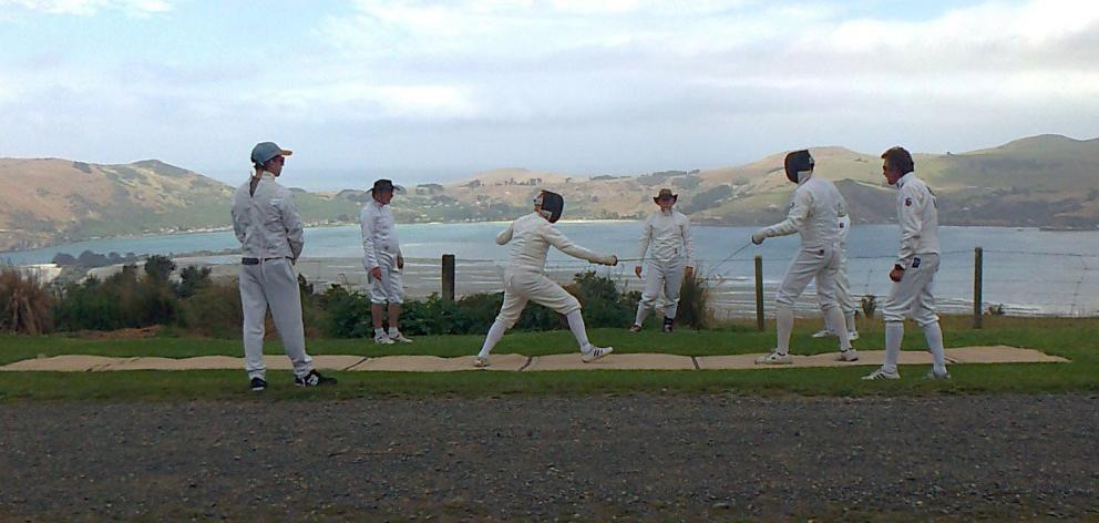 Members of the Salle Angelo Fencing Club duel at Heyward Point during the club's opening day last month. PHOTOS: SUPPLIED