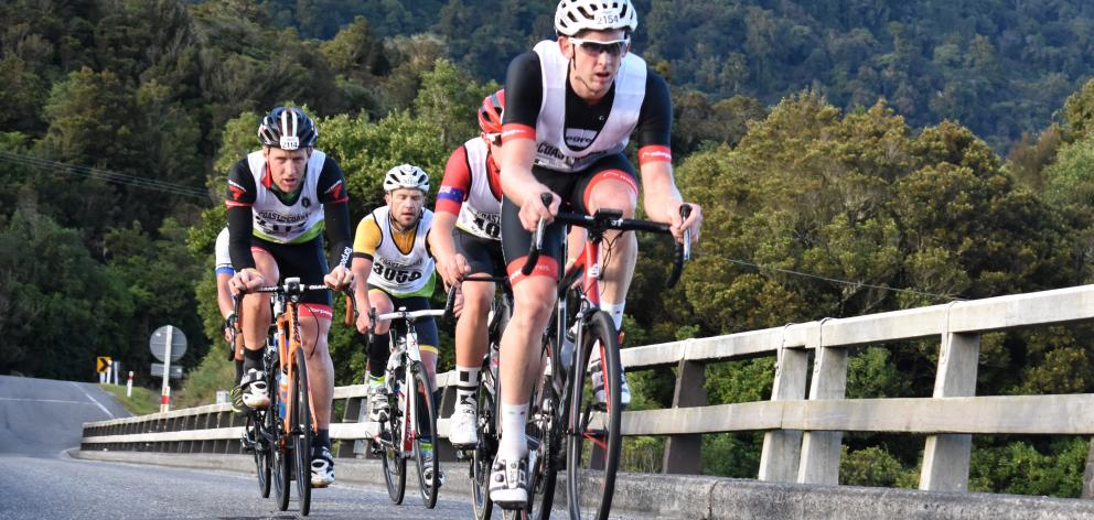 Sam Horgan leads the front group over Taipo River Bridge on day one of the two-day Coast to Coast...
