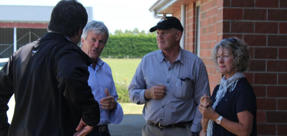 Minister for Agriculture Damien O'Connor (second from left) talks with DairyNZ Southland/South Otago regional manager Richard Kyte (back to camera) and Balfour dairy farmers Lyall and Jan Hopcroft last week about the drought at the Hopcrofts' farm. PHOTO:
