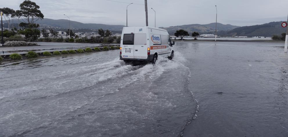 A delivery van ploughs through surface flooding at the intersection of Teviot St and Portsmouth...