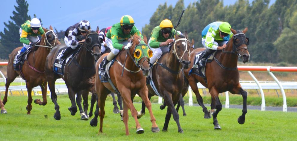 Tommy Tucker, with Shankar Muniandy (yellow and green cap) aboard, speeds past Gallant Boy ...